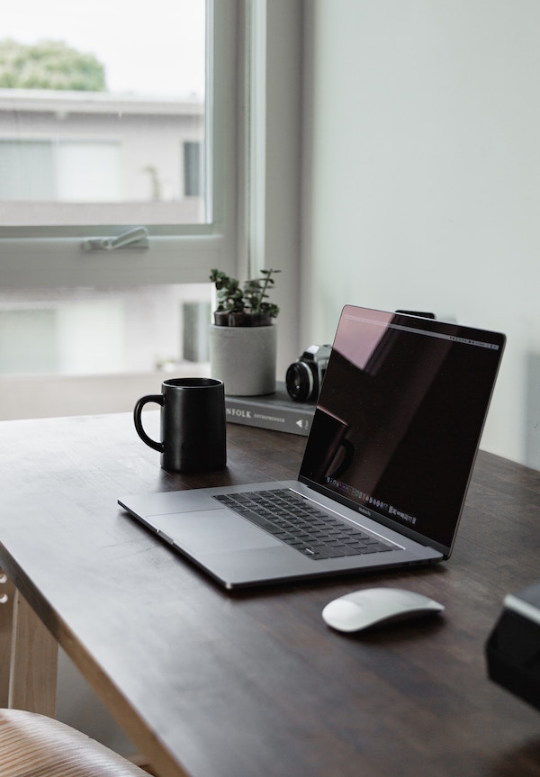 laptop home office email coaching business