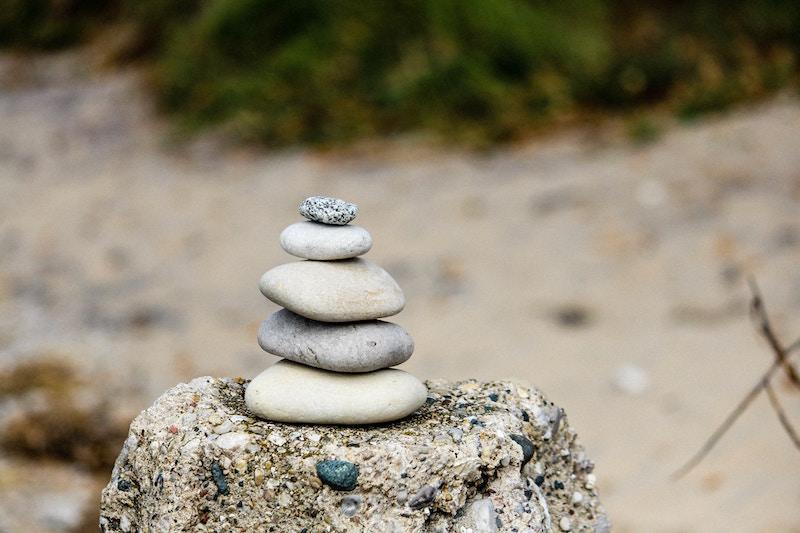 zen pebbles stack tower beach