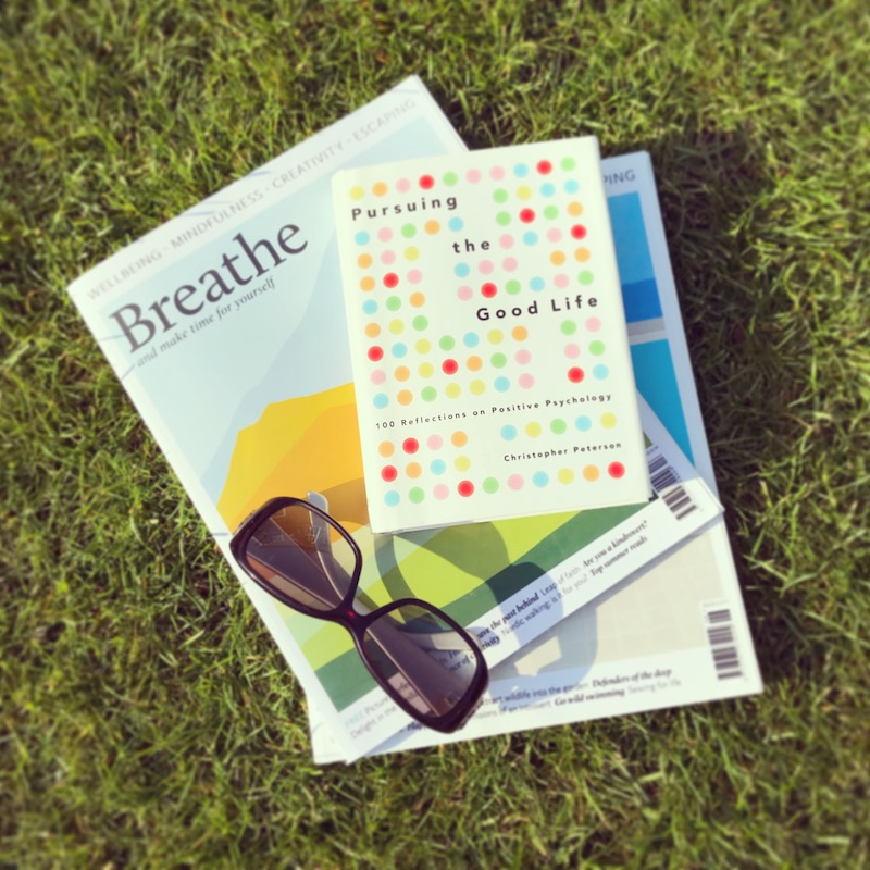 Breathe magazine good life book gucci sunglasses reading on lawn