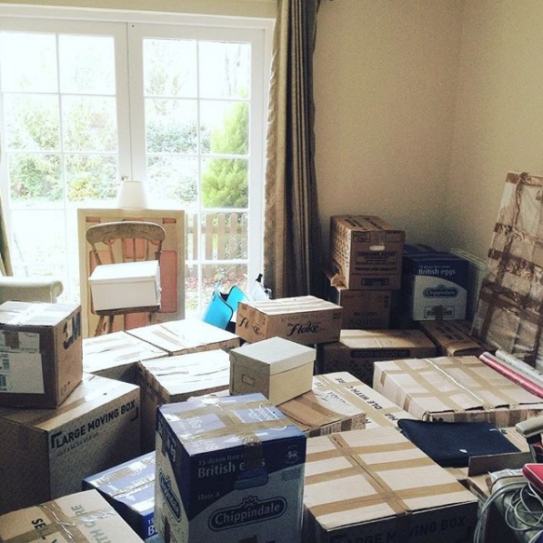 house moving boxes everywhere new home happy chaos