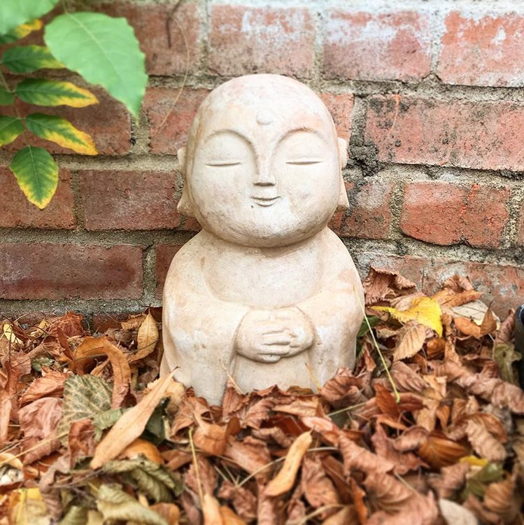 garden smiling buddha statue autumn leaves danielle raine creativity blog